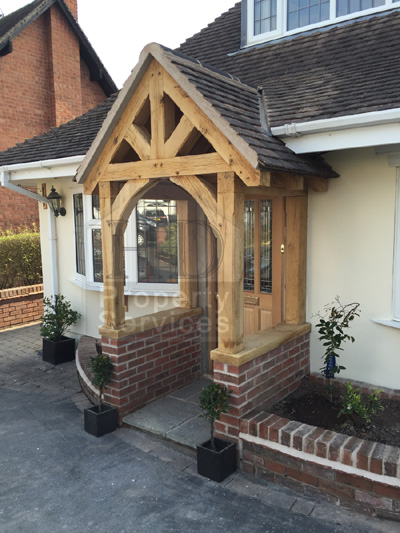 New front doorway with gabled canopy porch photo 2