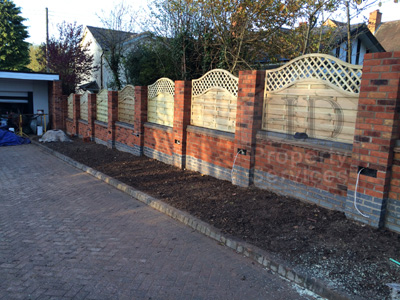 Gated Access with decorative walled fencing photo 10