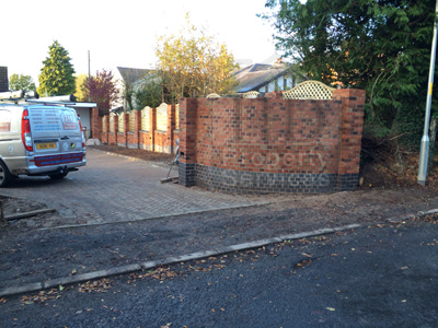 Gated Access with decorative walled fencing photo 11
