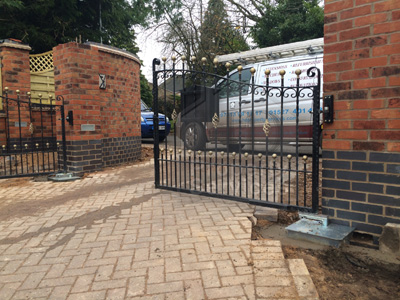 Gated Access with decorative walled fencing photo 12