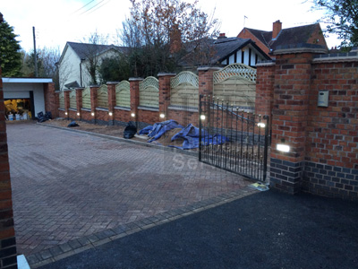 Gated Access with decorative walled fencing photo 13