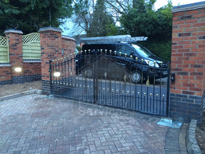 Gated Access with decorative walled fencing photo 14