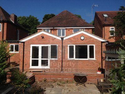 Single storey extension with double pitched roof photo 1