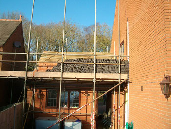 Removing & preserving the roof tiles (rear elevation)