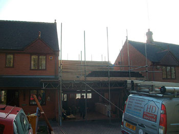 Removing & preserving the roof tiles (front elevation)