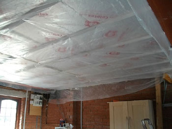 Floor insulation seen from the garage below