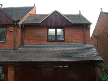 The completed exterior of over-garage extension (front elevation)