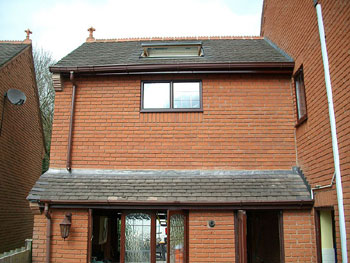 The completed exterior of over-garage extension (rear elevation)