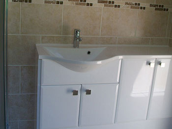 The completed en-suite shower room with concealed plumbing/waste