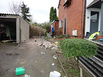 the original side path and garage space after demolition