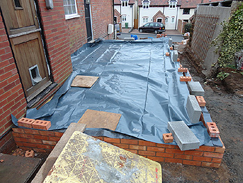 The damp proof membrane on the upper level