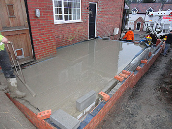 The concrete is added to the base