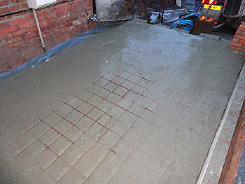 Steel reinforcement is added to the concrete base