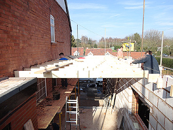 The first floor joists are secured into position