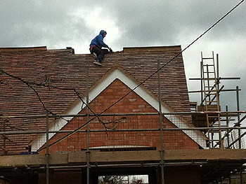 Our roofer works on the ridge tiles
