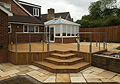 Large Decking Area With Feature Steps and Stone Patio Paving 1